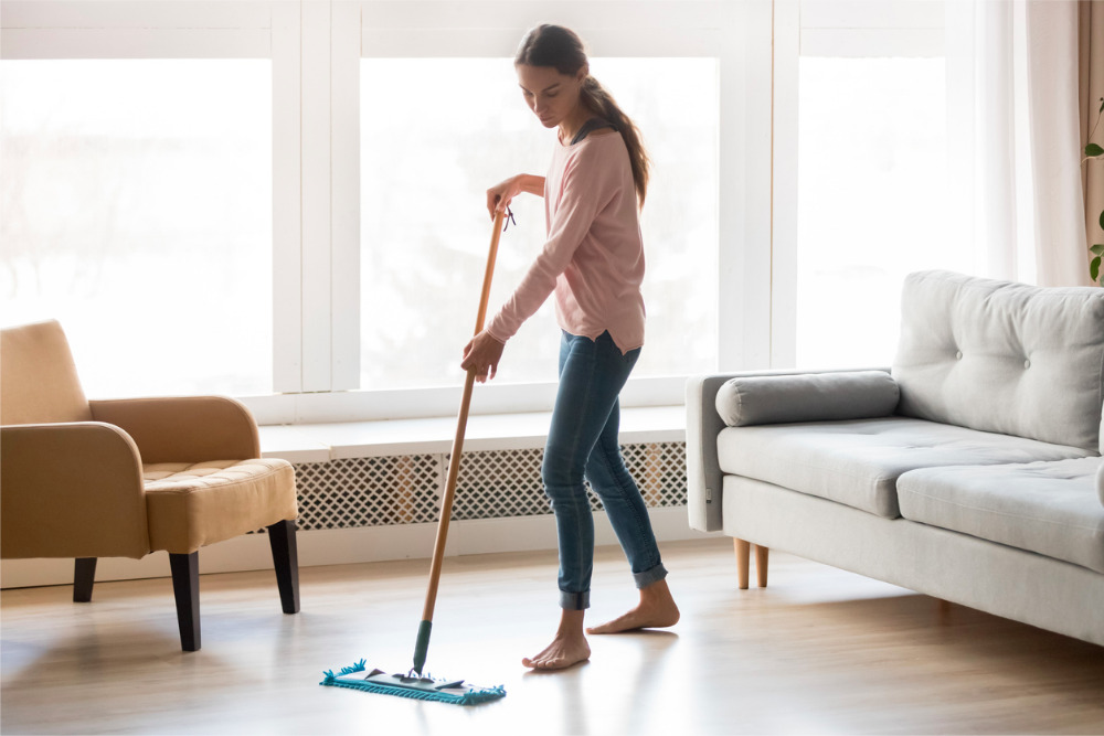 Woman-deep-cleaning-hardwood-floors
